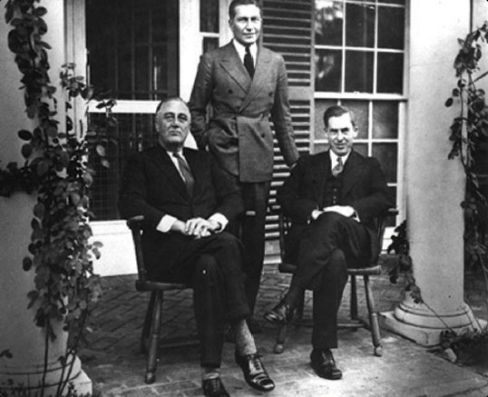 Figure 1-9. The third head of the Aeronautics Branch, Eugene L. Vidal, is flanked by President Franklin D. Roosevelt (left) and Secretary of Agriculture Henry A. Wallace (right). The photograph was taken in 1933. During Vidal's tenure, the Aeronautics Branch was renamed the Bureau of Air Commerce on July 1, 1934. The new name more accurately reflected the status of the organization within the Department of Commerce.