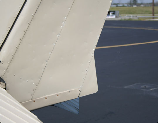 Figure 6-22. A ground adjustable tab is used on the rudder of many small airplanes to correct for a tendency to fly with the fuselage slightly misaligned with the relative wind.
