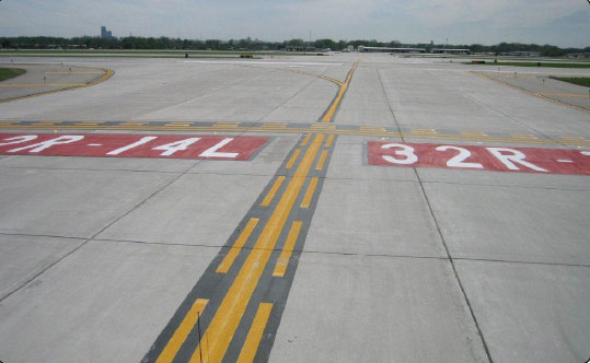 Figure 14-12. Surface painted runway holding position signs for Runway 32R-14L along with the enhanced taxiway centerline marking.