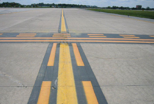 Figure 14-13. Surface painted holding position marking along with enhanced taxiway centerline.