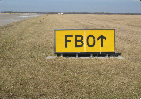 Figure 14-22. Destination sign to the fixed-base operator (FBO).