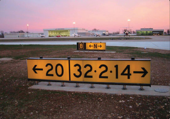 Figure 14-23. Runway destination sign with different taxi routes.
