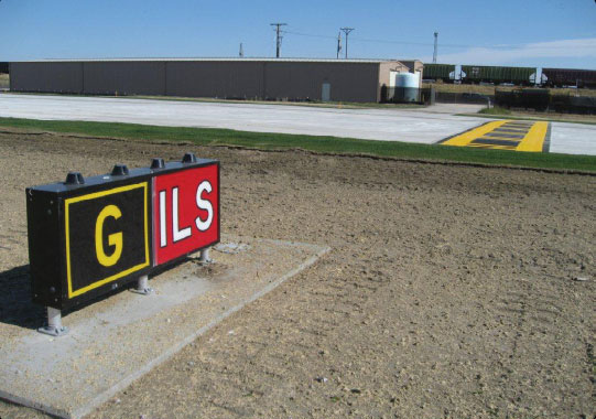 Figure 14-24. Instrument landing system (ILS) holding position sign and marking on Taxiway Golf.