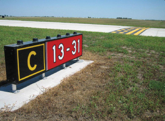 Figure 14-52. Runway 13-31 holding position sign and marking located on Taxiway Charlie.