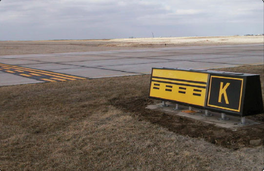 Figure 14-8. Runway safety area boundary sign and marking located on Taxiway Kilo.