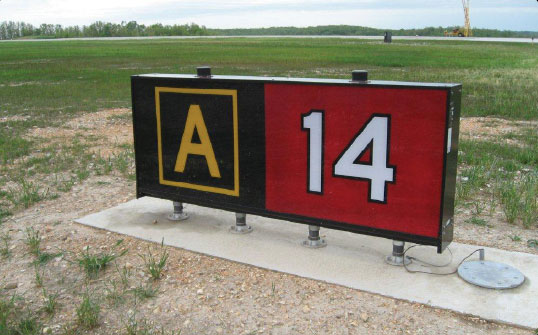Figure 14-9. Runway holding position sign at takeoff end of Runway 14 with collocated Taxiway Alpha location sign.