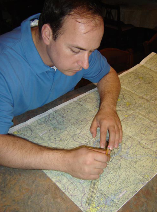 Figure 2-18. A student exhibits deliberate practice by plotting courses for his next training flight.