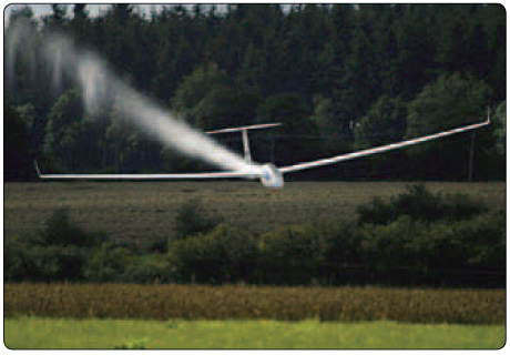 Figure 2-4. Sailplane dropping water ballast before landing.