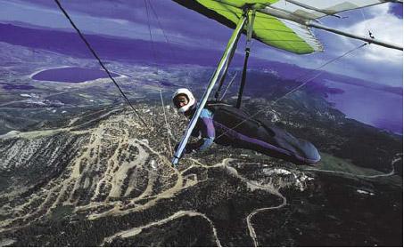 Figure 1-9. A modern high-performance hang glider soaring high over the mountains from which it was launched.