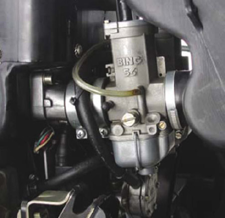 Figure 4-13. Typical two-stroke carburetor.