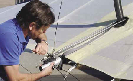 Figure 5-24. Attaching the tensioning cables to the back of the wing to complete the wing tensioning step.