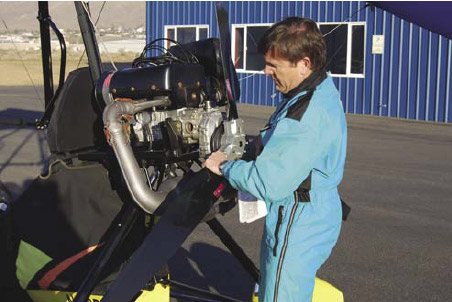 Figure 5-53. Checking the security of the engine to the airframe.