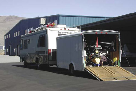 Figure 5-9. Enclosed trailer containing carriage and wing on top of RV.