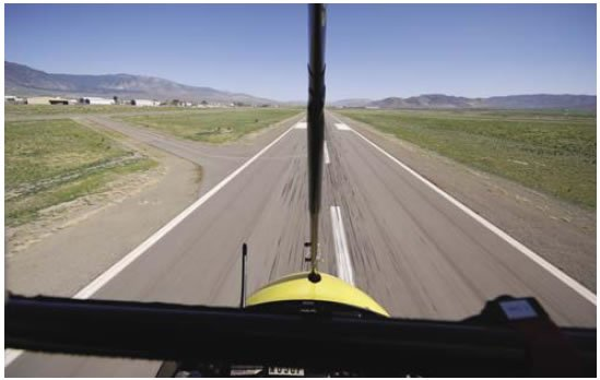 Figure 11-8. Starting the roundout by increasing angle of attack (AOA) slightly at about 10 to 15 feet above the runway.