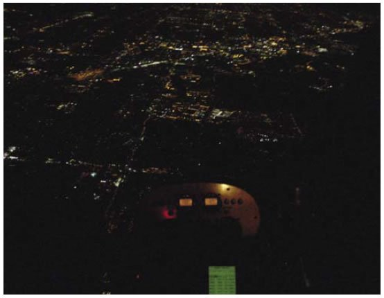 Figure 12-11. A properly lit instrument panel and city lights provide recommended conditions for night flying.