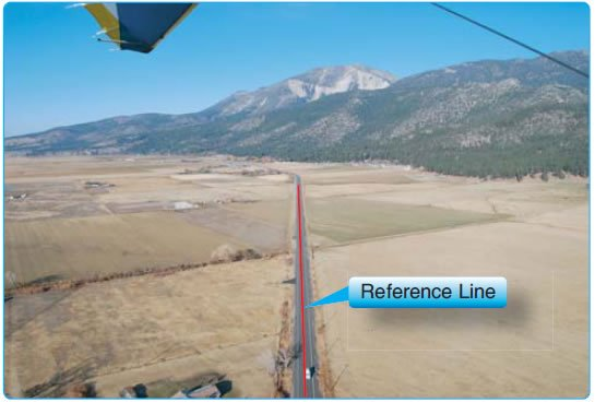 Figure 9-7. Pilot's view of crossing a reference line (road) at 90° wings level starting the S-turn maneuver.