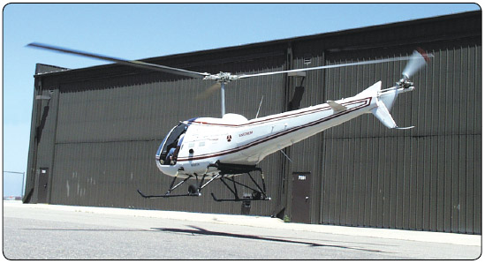 Figure 8-2. Exercise extreme caution when hovering near buildings or other aircraft.