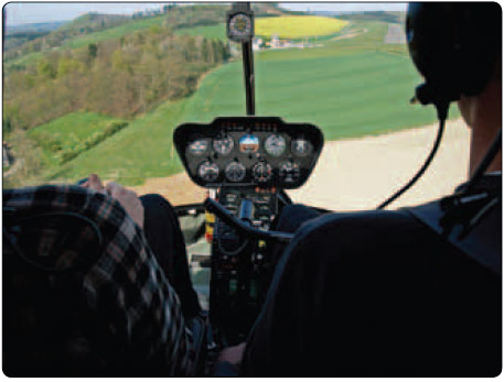 Figure 1-1. As part of flight training, a pilot instructs a student on proper techniques for landing at an airport.